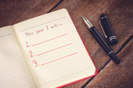New Year Resolution, Empty list. on wooden table