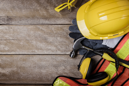 Photo for Standard construction safety equipment  on wooden table. top view - Royalty Free Image