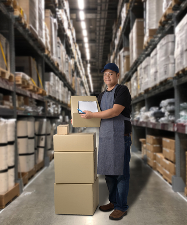 Photo for Worker Delivering products Sign the signature on the product receipt form with parcel boxes Blurred the background of the warehouse - Royalty Free Image