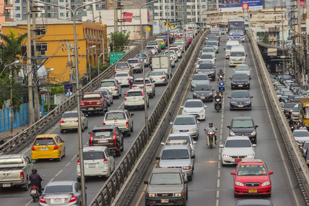 BANGKOK, THAILAND - June 31, 2016: Traffic reaches gridlock on a busy city centre road. Each year an estimated 150,000 cars join the heavily congested streets of the Thai capital.