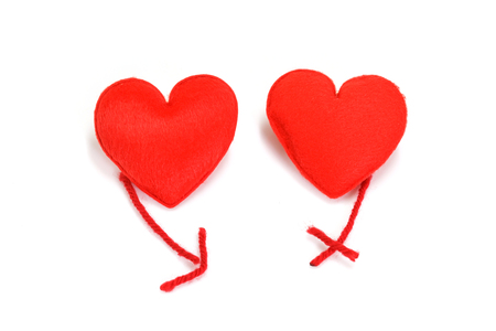 Two red hearts in love on white background