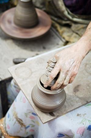 potter man hands shaping ceramic craft, Khun-Ream water market , Thailand