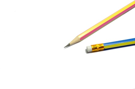 Two wooden sharp pencils isolated on white background