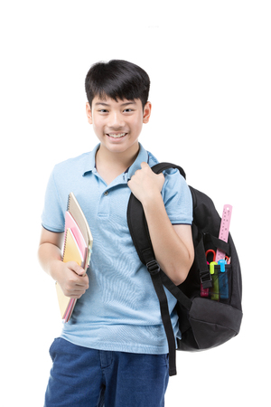 Photo pour Portrait of smiling little student boy in blue polo t-shirt in with books and bag over white background - school, education and people concept - image libre de droit