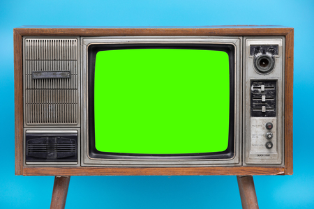 Photo pour Vintage TV : old retro TV set isolated on blue background.  Bank Green sceen with copy space . - image libre de droit