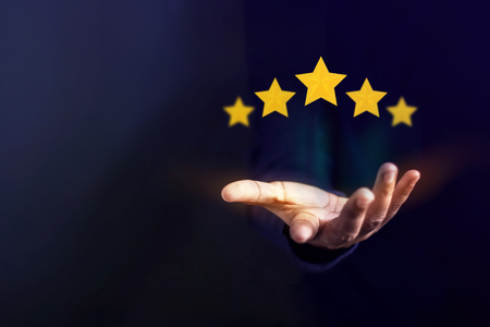 Photo pour Customer Experience Concept, Best Excellent Services for Satisfaction present by Opened Hand of Client giving a Five Star Rating - image libre de droit