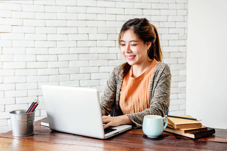 Foto de Happy Young Freelancer Woman Working on Computer Laptop in Cozy House, Modern Lifestyle of New Generation People - Imagen libre de derechos