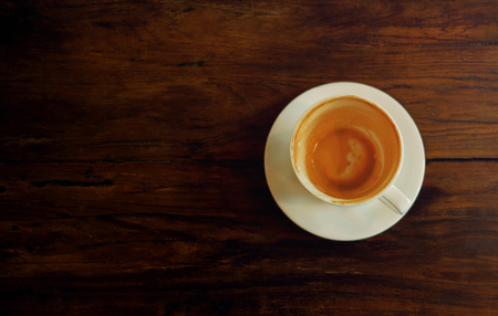 Photo pour Coffee Cup on Wooden Table. Finished Latte or Cappuccino. Top View - image libre de droit
