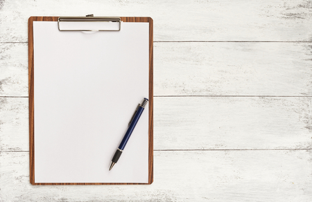 Blank paper on wooden clipboard with space on background