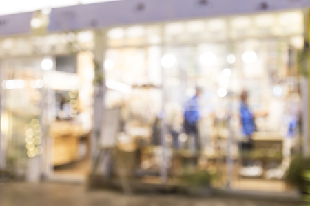 Abstract blurred shop with light bokeh, business concept background