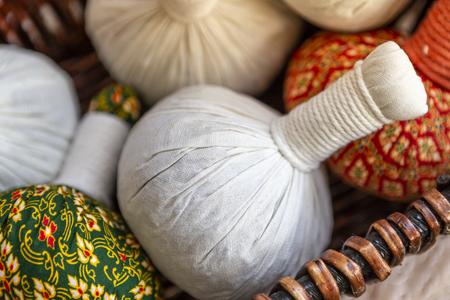 Closeup Thai herbals massage ball in wooden besket, health object concept