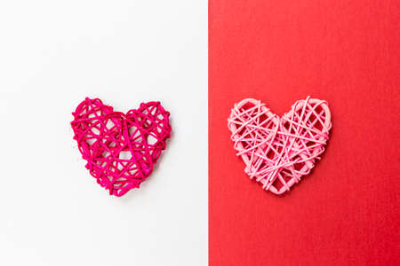 Photo pour Wooden heart design on red and white paper background, love and romance symbol, valentine concept background - image libre de droit