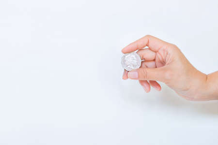 Photo pour Girl hand holding Australian dollar coin on white background, money exchange concept, banking and finance idea - image libre de droit