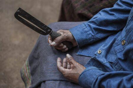 Vintage filter : Old women holding her paring knife