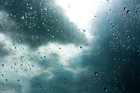 Drops of rain on glass , rain drops on clear windowの写真素材