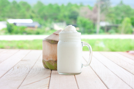 coconut milk smoothie on a wooden tableの写真素材