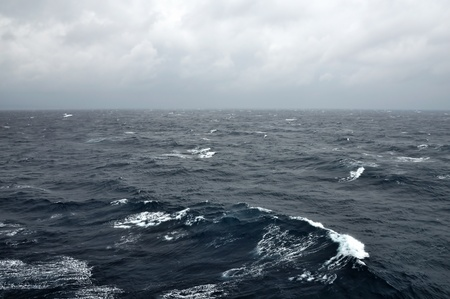 Deep sea water waves and stormy sky.