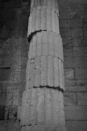 Unstable ancient greek column. Marble pillar unbalanced structure black and white.
