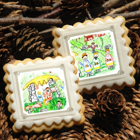 Christmas cookies, decorated with children's drawings Magi and Nativity scene