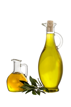 Photo pour Extra Virgin olive oil in two glass rustic  bottles and leaves  isolated over a white - image libre de droit