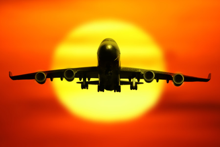 passenger plane on sky at sunset time very beautiful , use for air transport ,journey and travel industry business