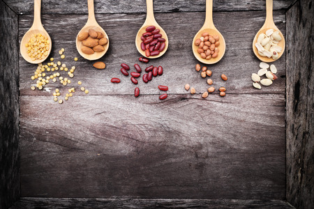 Natural raw nuts food mix on wooden background