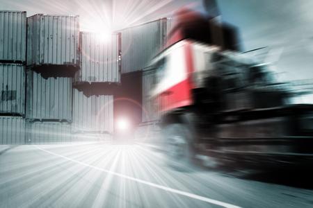 Foto de Generic big trucks speeding on the highway at sunset - Transport industry concept , big truck containers - Imagen libre de derechos