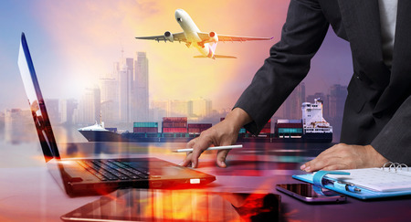 businessman working with Container Cargo ship and Cargo plane with big city  in seaport , logistic import export background and transport industry.