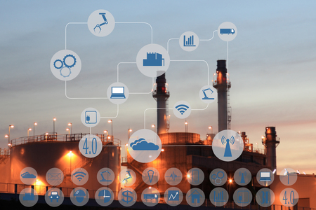 Foto de Industry 4.0 concept image.Oil refinery at twilight with cyber and physical system icons diagram on industrial factory and infrastructure background. - Imagen libre de derechos
