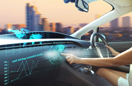 Photo pour self-driving autopilot mode , autonomous car, vehicle running self driving mode and a woman driver  - image libre de droit