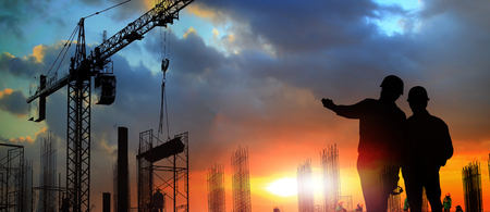 Photo pour two engineer on working site , engineer and tower cranes at construction site and city background  - image libre de droit