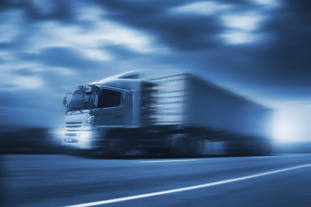 Foto de Truck run on road, transportation logistic concept - Imagen libre de derechos