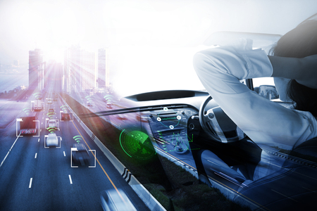 Photo pour electric car or intelligent car.Heads up display(HUD).futuristic vehicle and graphical user interface(GUI).self-driving mode , autonomous car, vehicle running self driving mode and a woman driver - image libre de droit
