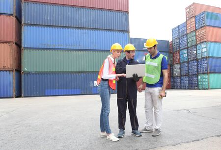 Photo for Engineering team working and  loading container for support logistics and import export business - Royalty Free Image