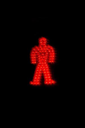 Symbol not go through pedestrian in red light on dark background - Simbolo de no pasar con peaton en semaforo en rojo sobre fondo oscuro // semaforo, rojo, peaton, no pasar, prohibido, humano, figura, simbolo, luz, piloto,  encendido, alto, pare,  indicad
