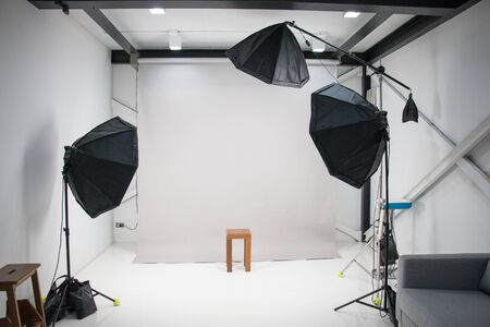 Photo for in a photography studio have three umbrella flash light are setting standby for work - Royalty Free Image