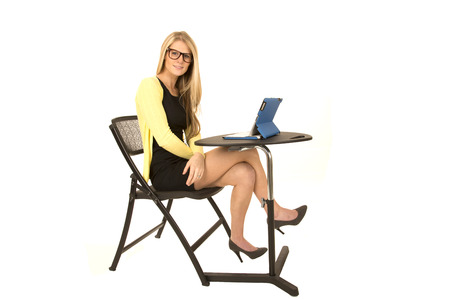 pretty blonde with glasses sitting at desk
