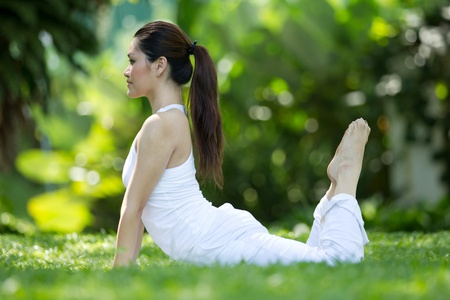 Photo for Woman in white Performing yoga in natural setting - Royalty Free Image