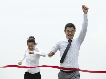 Photo pour Conceptual image of an Asian Business man winning a race - image libre de droit