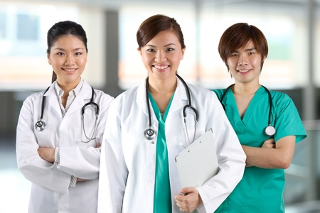 Three Asian doctor wearing a white coats with stethoscope's.の写真素材