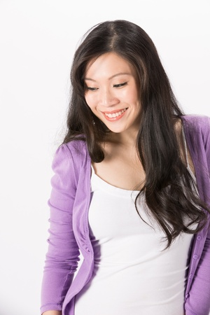 Happy Asian woman looking down. Isolated on white background.