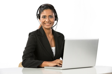 Portrait of a happy young Indian female call centre employee with a headset. Isolated on a white background.