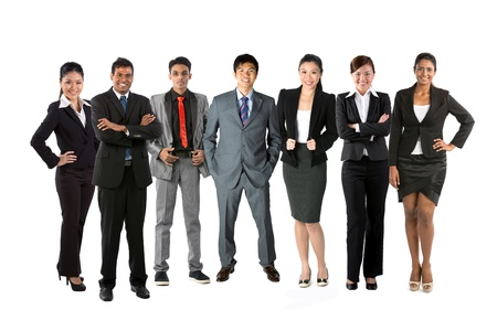 Full length Portrait of a multi-culural business team. Isolated on a white background.の写真素材