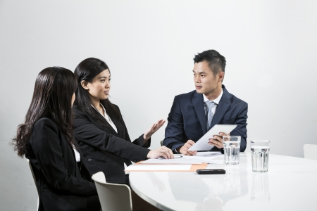 Photo for Group of Chinese business people having meeting together - Royalty Free Image