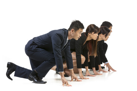 Chinese business team ready to start a race. Conceptual image about competition. Isolated on white background.