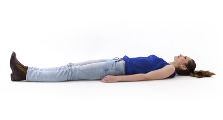 Caucasian woman lying on floor. Full-length image. Isolated on white background.