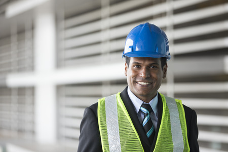 Photo for Portrait of a male Indian, industrial engineer at work. Asian engineer smiling & looking at the camera. - Royalty Free Image