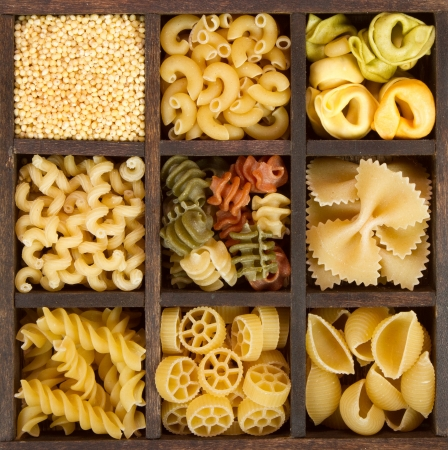 an assortment of italian pasta, nine different varieties separated in a decorative box