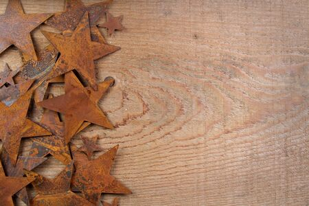Rusty starts on a wooden background, room for copy space