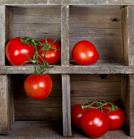 Tomatoes in a vintage wooden crate, decorative
